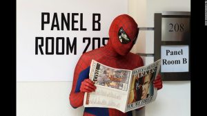 Even a superhero needs to take a break every now and then and catch up on the news.